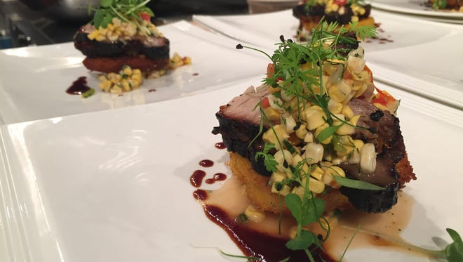 Smoked Indiana pork brisket with fermented sweet corn–tomato salad and hot water cornbread was among dishes Indiana chefs cooked for a 2015 dinner at the James Beard House in New York City. Indianapolis chefs cooked at the house again in December 2016.