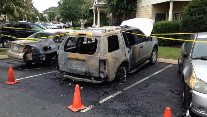 Three vehicles and a door to an apartment were on fire at 5:30 a.m., today at Camellia Trace Apartments.
