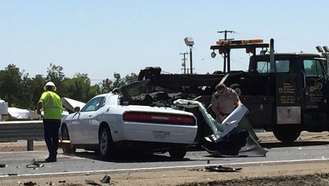 A collision between a car and a truck hauling a trailer shut down westbound traffic on Highway 198 on Monday afternoon in Visalia.