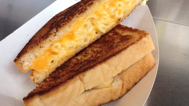 Hit the Ultimate Grilled Cheese contest  Aug. 13 at Indiana State Fair. You might find something like this  Macaroni and cheese grilled cheese sandwich, served by the Big Cheeze food truck at the 2015 Indiana State Fair.