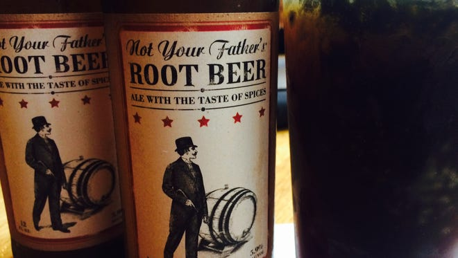 Not Your Father's Root Beer by Small Town Brewery in Wauconda, Ill., kicked off a rush for alcoholic root beer that's cleared shelves across metro Detroit. Shown here at Redsmoke Barbecue in downtown Detroit.
