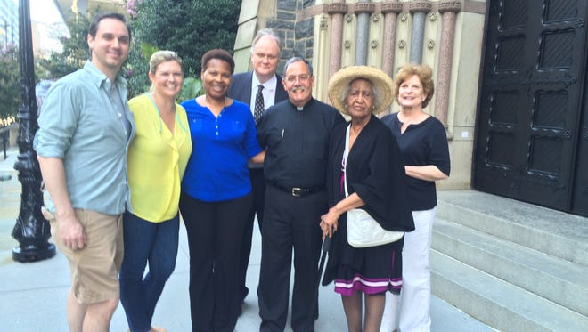 Monsignor Sal Criscuolo is surrounded by some of the lucky St. Patrick's parishioners who will be inside the church when Pope Francis visits on Sept. 24, 2015. From left, Andrew Mullins, Alice Mullins, B. Michelle Harris, Bill McGrath, Criscuolo, Eloise Harris and Brenda McGrath.