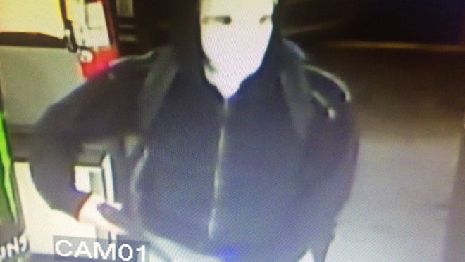 Surveillance photo of robber at the Mobil On The Run,  Friday
