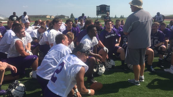 Jed Stugart addresses his team after a successful opening
