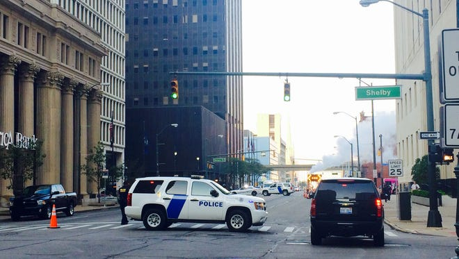 Officers with the Department of Homeland Security's Federal Protective Service block Fort Street near the federal courthouse Monday morning as a suspicious package is investigated.