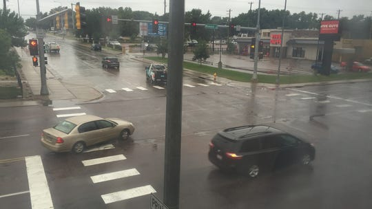 A rain-drenched photo of the flashing yellow turn light