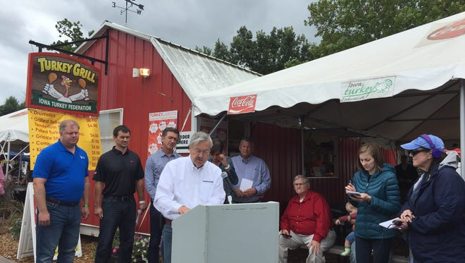 Gov. Terry Branstad, at the lectern, speaks at a press conference focused on bird flu Wednesday, Aug. 19, 2015, at the Iowa State Fair.
