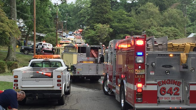 Fire fighters and emergency crews battle a house fire on Boyd Street in Boonton.