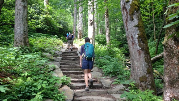 Anna Lee Zanetti of Friends of the Smokies climbs the newly rehabilitated Chimney Tops Trail in Great Smoky Mountains National Park.