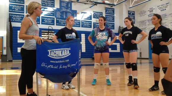 Suffern head coach Samantha Gutmann talks to her players