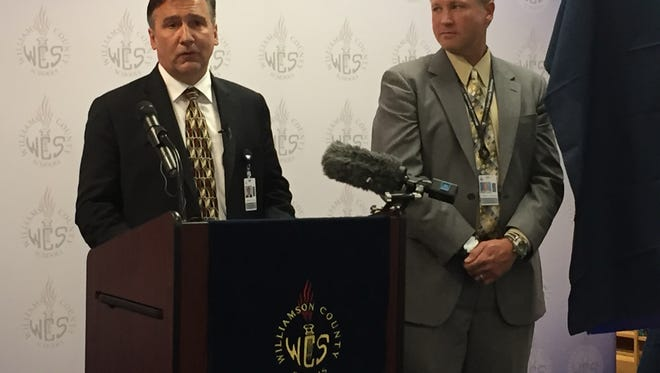 Williamson County Director of Schools Mike Looney, left, discusses the news that the school district's ACT average score has risen to 23.8.