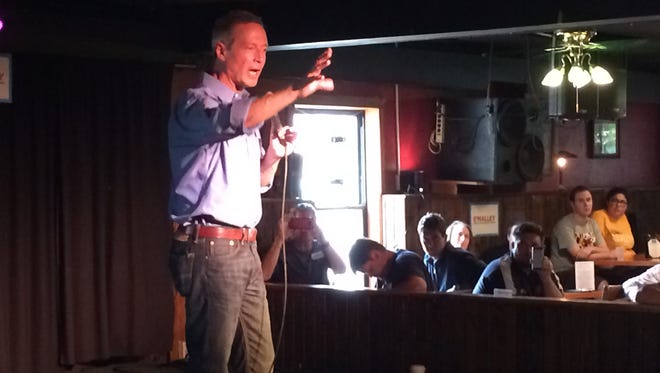 Democratic presidential candidate and former Maryland governor Martin O'Malley gestures during a speech at The Mill in Iowa City on Sunday.