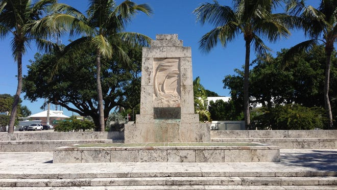 """The plaque on a memorial in Islamorada reads """"Dedicated to the Memory of the Civilians and War Veterans Whose Lives Were Lost in the Hurricane of September Second, 1935."""" Photo by Jason Clingerman."""