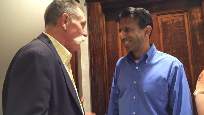Host Mark Leonard speaks with Gov. Bobby Jindal at his home in Holstein during a meet and greet Wednesday evening.