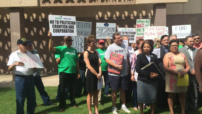 Teachers, union members and education advocates rally at the state Capitol in support of increased school funding.