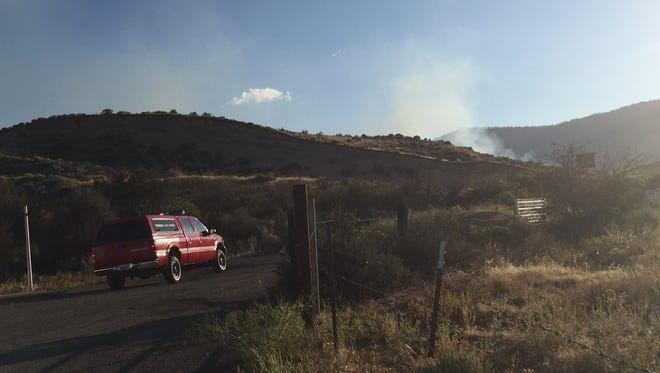 Brush fire burning south of Boomtown Casino