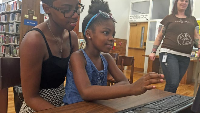 Lauren Wright and daughter Aubrey put in some time at Staunton Public Library Friday before Aubrey starts school on Tuesday.