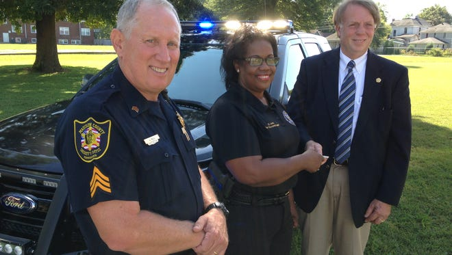 Sgt. Joe Gill, Brenda Jones and Sheriff John Mehr with a 2015 Ford Explorer won by the Madison County Sheriff's Department in a statewide competition.
