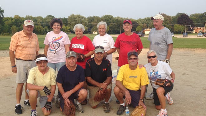 Eleven members of the community gather to play baseball at Lakeside Elementary on Aug. 31.