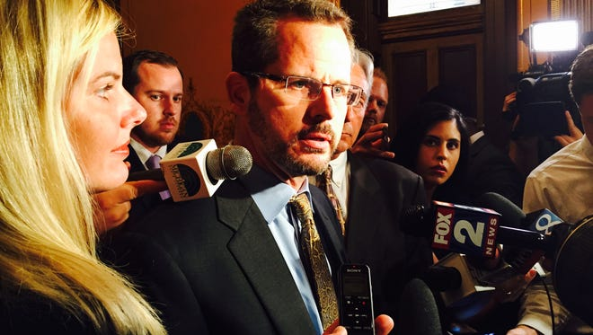 Rep. Todd Courser speaks after the committee meeting.