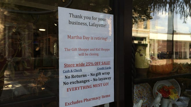 A sign on the door of Teche Gift Shoppe announces its closing. The store is located in downtown Lafayette.