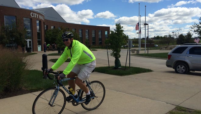 Joe Cory, deputy director of Public Works, leads a group of city officials on a tour of West Des Moines with a representative from The League of American Bicyclists.