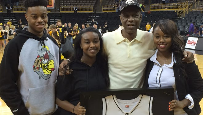 Roy Marble with children Carlo, Roichelle and Royonah when Iowa honored him March 8. Marble died on Friday, Sept. 11, 2015.