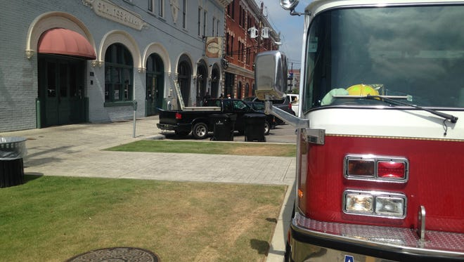 A fire engine sits Friday outside Central restaurant at 129 Coosa St. in downtown Montgomery.