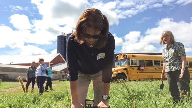 Brenda Fritsch, who owns farmland in Outagamie County, tries out a soil-testing penetrometer during a workshop in Freedom.