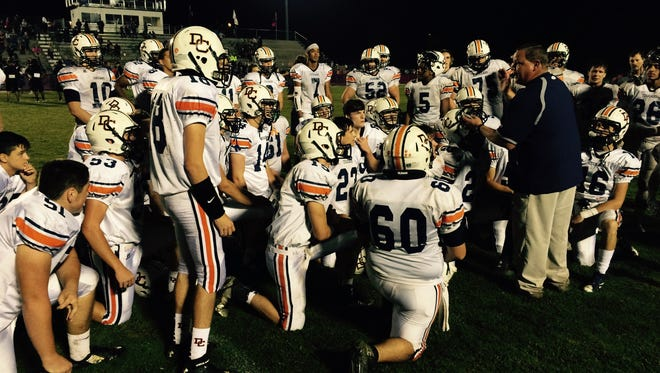 Dickson County High football coach Troy Williams congratulates his team after Friday's win at Spring Hill in OT.