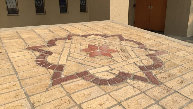 A mosaic outside the Temple Emanu-el in Reno displaing the Star of David. The mosaic was discovered when Harrah's Hotel built their casino. It's believed to have come from a ritual bath.
