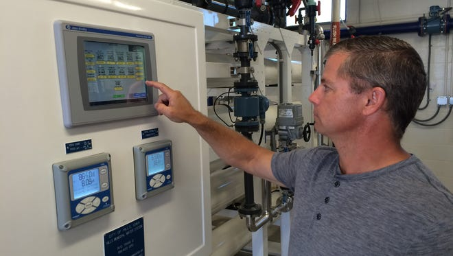 Water plant operator Steve Flake shows off the controls on the new Hills water treatment plant's reverse osmosis filter at an open house on Sept. 13.