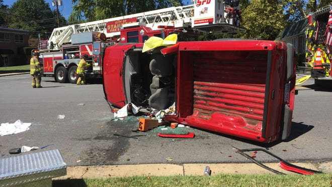A pickup truck rests on its side at the intersection of North Coalter Street and Mountain View Drive in Staunton after a single vehicle accident Monday, Sept. 14, 2015.