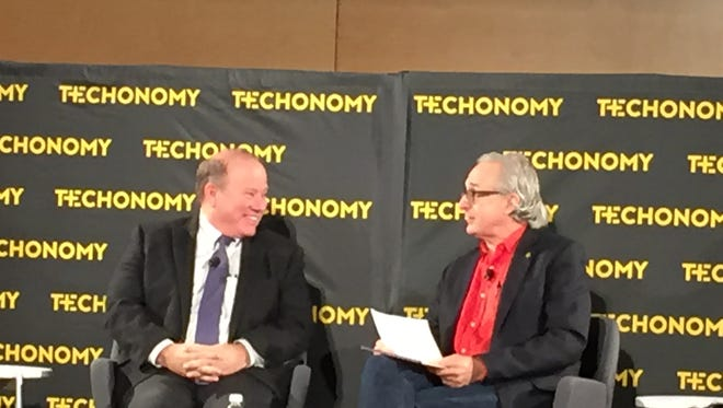 Mayor Mike Duggan (left) speaks with Techonomy founder David Kirkpatrick  at the 2015 Techonomy Detroit conference at Wayne State University on Tuesday.