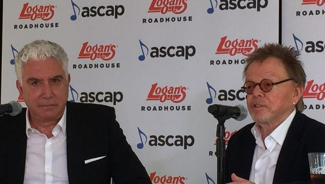 Logan's Roadhouse CEO Sam Borgese and ASCAP President and Chairman Paul Williams discuss a new partnership between the two organizations on Tuesday at Logan's Roadhouse on Elliston Place in Nashville