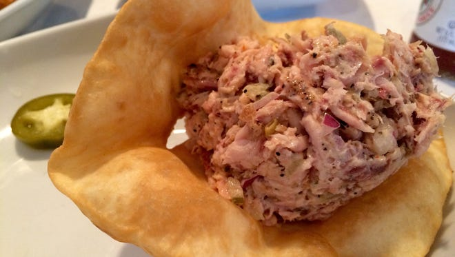 At Blue Dog on Matlacha, the smoked fish dip is often made from flakes of smoked local mullet, onions, pickles and just a kiss of mayonnaise to keep things together.