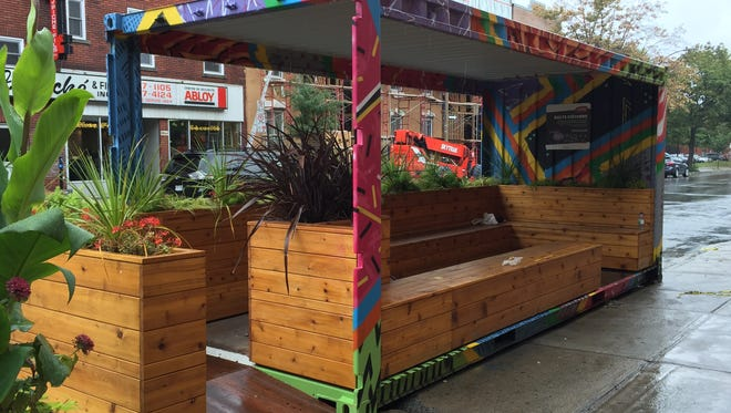 Montreal has experimented with using empty shipping containers to create lively street scenes, like this seating unit made out of an empty shipping container as shown in this September 2015 photo.