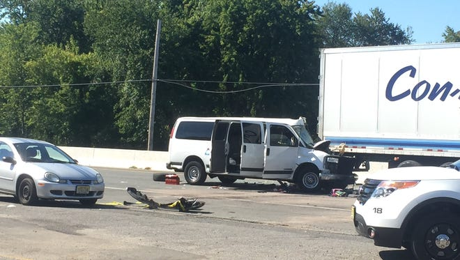 Route 9 in Howell was shut down Friday morning after a van collided with a tractor trailer.