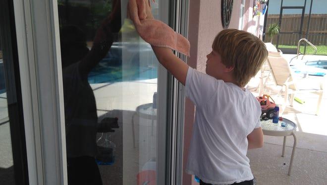 Momsense columnist Sara Paulson has her 8-year-old son clean the sliding glass doors on a regular basis.