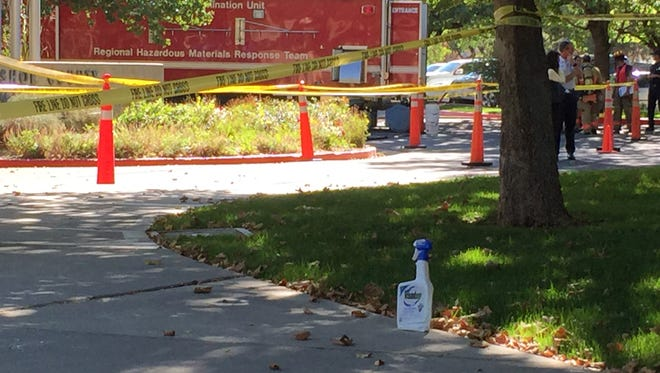 A Roundup bottle rests on the ground Monday, Sept. 21, 2015, where a man who has been complaining at Reno City Council meetings about pesticides in the drinking water was tackled and arrested by police after pulling a Roundup bottle out of his sweatshirt and threatening to drink. The building was evacuated.