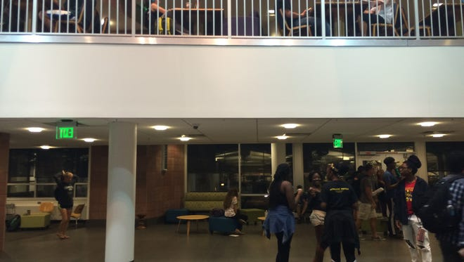 People stand inside the lobby of CSU's Morgan Library on Tuesday night.