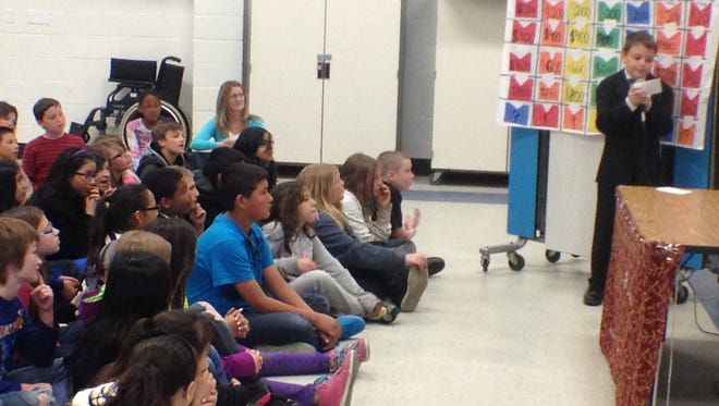 A fifth grade gifted and talented student at Stead Elementary School leads a game of Jeopardy!