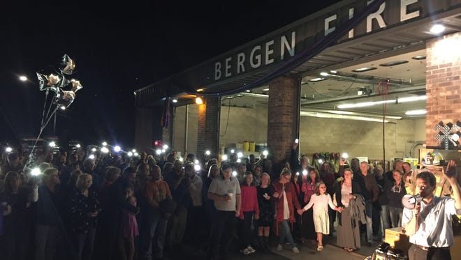 Community members and fellow first responders gather at the Bergen Fire Department on Wednesday evening to remember fallen EMT Barry Miller.