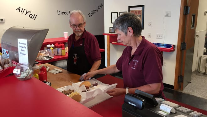After 17 years away, Jerry Bumgarner, left, and his wife Penny, right, reopened JB's Barbeque in its original Simpsonville location last year.