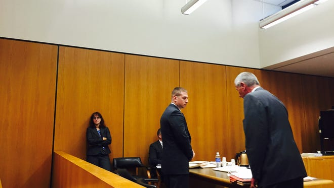 Former Lakewood police officer Jeremy Felder stands to be sentenced for covering up an illegal search.