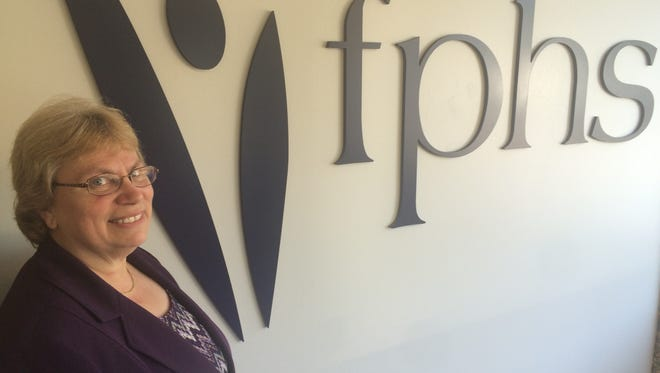 Ruth Dayton, interim executive director of Family Planning Health Services, poses for a photo on Friday at the organization's Wausau office.