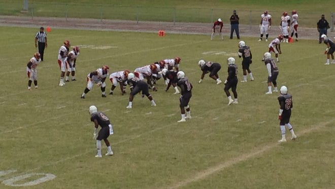 Lane's defense gets ready for Tuskegee to run a play Saturday at Lane Field.