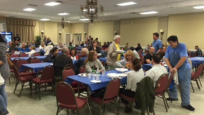 Attendees sit down inside the Saint Barbara Greek Orthodox Church to eat during the Greek Festival on Sunday, September 27, 2015