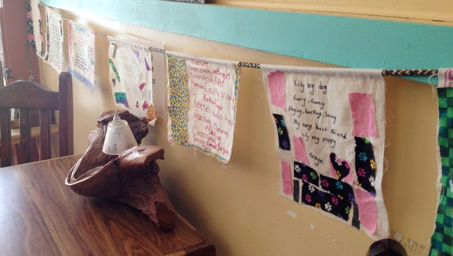 Poetry flags from Stout Elementary students are displayed at Yankie Creek Coffeehouse.