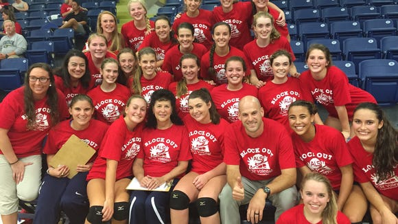 The Roberson volleyball team and Pam Sizemore.